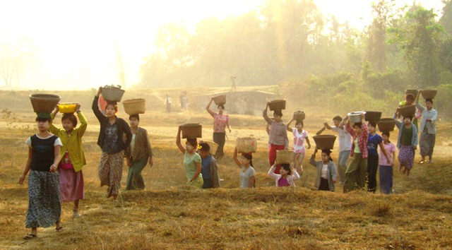 Pata Villagers carrying sand for school building WEB