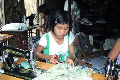 Teenage Girls Learning To Sew